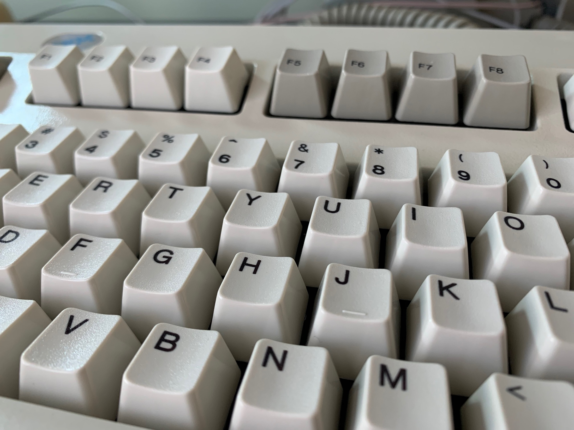 A closeup of an IBM Model M keyboard with very clean keys.