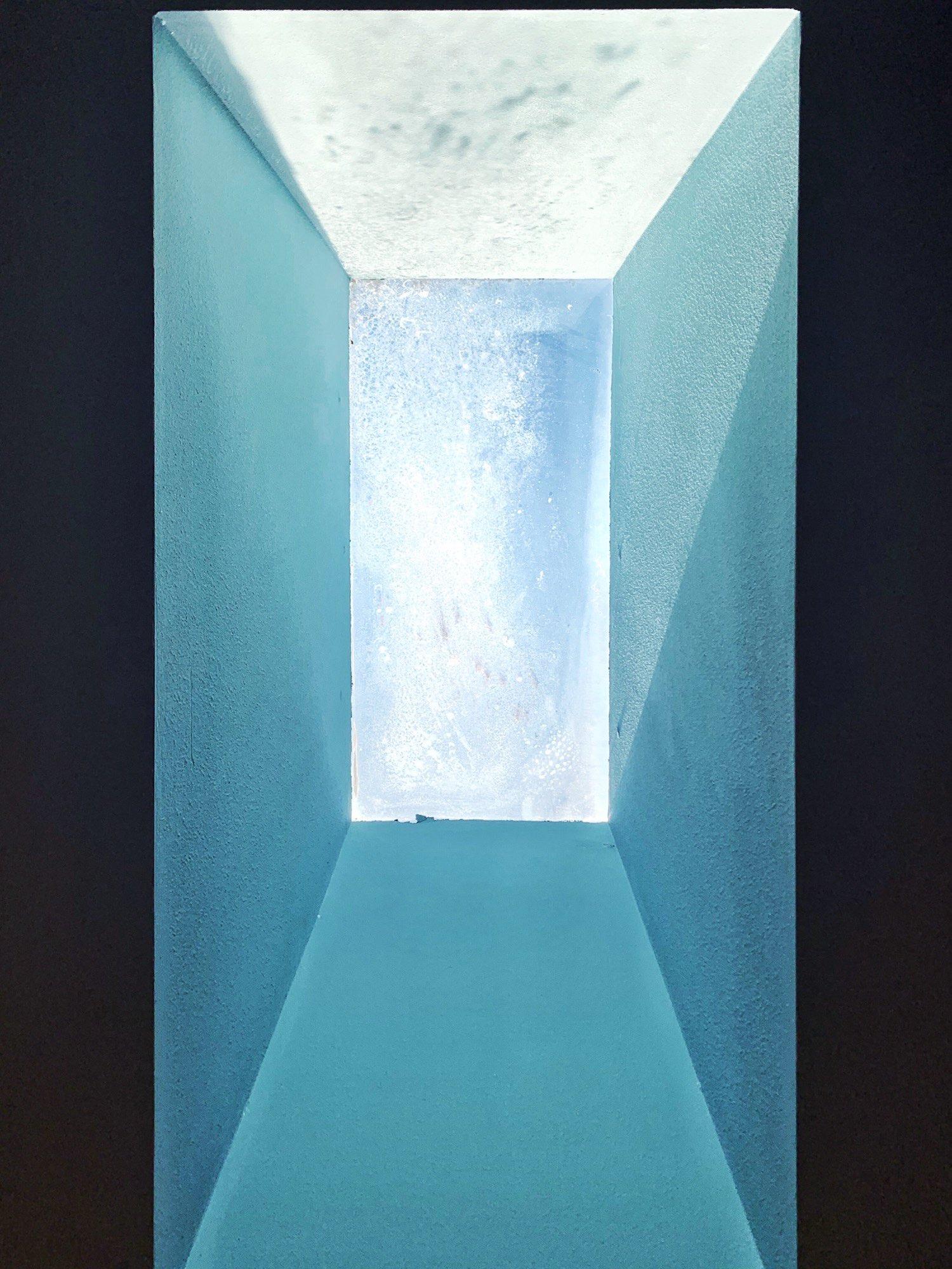 Symmetrical photo of a skylight, midday.